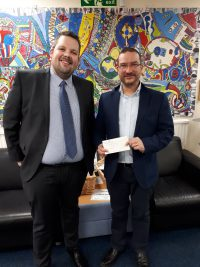 Mark Monteith presents a sponsorship cheque