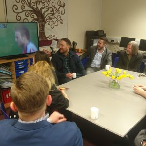 The group watch clips of Morgan Stoddart's rugby achievements